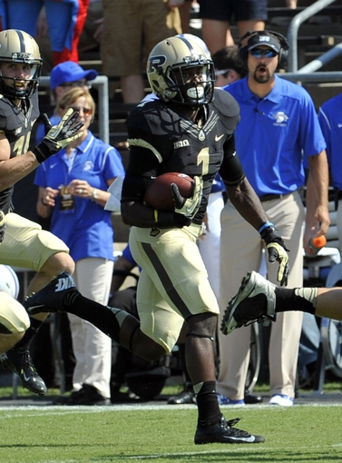 Sep 7, 2013; West Lafayette, IN, USA; Purdue Boilermakers running back Akeem Hunt (1) runs the ball during the first half against the Indiana State Sycamores at Ross Ade Stadium. Mandatory Credit: Sandra Dukes-USA TODAY Sports