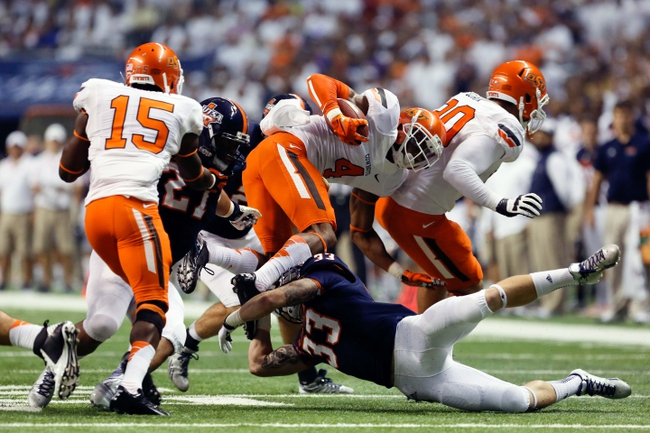 Sep 7, 2013; San Antonio, TX, USA; Oklahoma State Cowboys corner back Gilbert, Justin (4) is tackled by Texas-San Antonio Roadrunners corner back Dahlquist, Chase (33) during the first half  at Alamodome. Mandatory Credit: Soobum Im-USA TODAY Sports