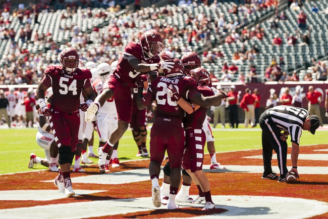 Sep 7, 2013; Philadelphia, PA, USA; Temple Owls running back Kenneth Harper (20) celebrates scoring a touchdown with teammates during the second quarter against the Houston Cougars at Lincoln Financial Field. Mandatory Credit: Howard Smith-USA TODAY Sports