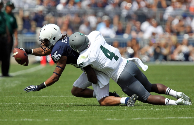 Sep 7, 2013; University Park, PA, USA; Penn State Nittany Lions wide receiver Brandon Felder (85) is tackled by Eastern Michigan Eagles defensive back Willie Creear (4) during the second quarter at Beaver Stadium. Mandatory Credit: Matthew O'Haren-USA TODAY Sports
