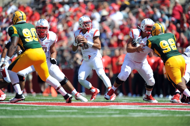 Sep 7, 2013; Piscataway, NJ, USA; Rutgers Scarlet Knights quarterback Gary Nova (10) drops back to pass against the Norfolk State Spartans during the first half at High Point Solutions Stadium. Mandatory Credit: Joe Camporeale-USA TODAY Sports