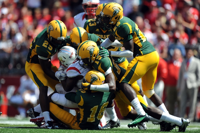 Sep 7, 2013; Piscataway, NJ, USA; Norfolk State Spartans defenders tackle Rutgers Scarlet Knights running back Savon Huggins (28) during the first half at High Point Solutions Stadium. Mandatory Credit: Joe Camporeale-USA TODAY Sports