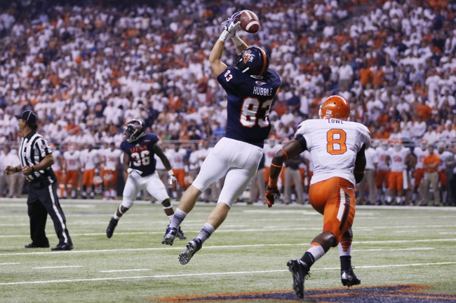 Sep 7, 2013; San Antonio, TX, USA; Texas-San Antonio Roadrunners tight end Hubble, Cole (83) unable to make a catch while defended by Oklahoma State Cowboys safety Lowe, Daytawion (8) during the first half  at Alamodome. Mandatory Credit: Soobum Im-USA TODAY Sports
