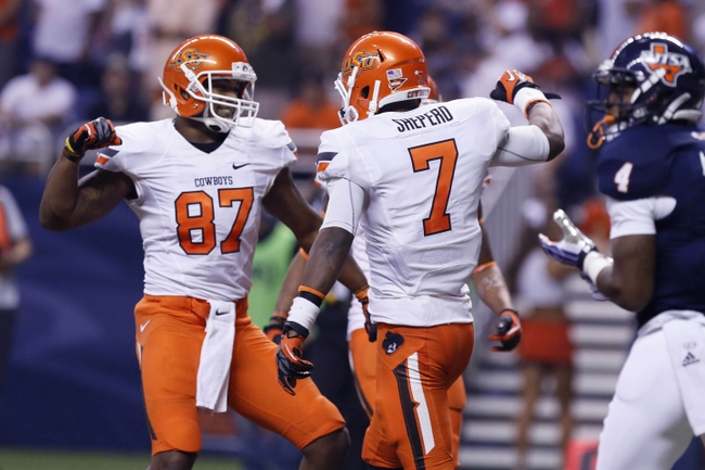 Sep 7, 2013; San Antonio, TX, USA; Oklahoma State Cowboys wide receiver Sheperd, Brandon (7) is congratulated by teammate wide receiver Moore, Tracy (87) after scoring a touchdown against the Texas-San Antonio Roadrunners during the first half  at Alamodome. Mandatory Credit: Soobum Im-USA TODAY Sports