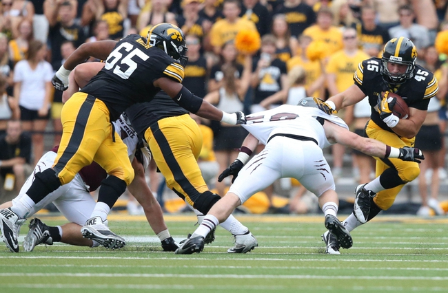 Sep 7, 2013; Iowa City, IA, USA;  Iowa Hawkeyes running back Mark Weisman (45) avoids the tackle by Missouri State Bears linebackerJeremy Springer (6) at Kinnick Stadium.  Mandatory Credit: Reese Strickland-USA TODAY Sports