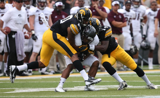 Sep 7, 2013; Iowa City, IA, USA; University of Iowa linebacker Christian Kirksey (20 ) and cornerback Desmond King (14) tackle Missouri State Bears wide receiver Julian Burton (3) during the first quarter at Kinnick Stadium.  Mandatory Credit: Reese Strickland-USA TODAY Sports