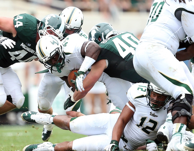 Sep 7, 2013; East Lansing, MI, USA;South Florida Bulls running back Michael Pierre (45) is tackled by Michigan State Spartans linebacker Max Bullough (40)  during the first half at Spartan Stadium. Mandatory Credit: Mike Carter-USA TODAY Sports