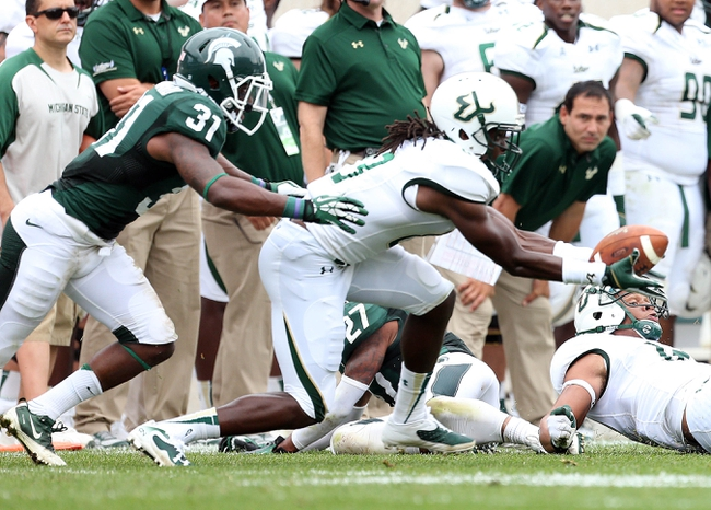 Sep 7, 2013; East Lansing, MI, USA; South Florida Bulls wide receiver Deonte Welch (83) attempts to catch the ball against Michigan State Spartans cornerback Darqueze Dennard (31) during the first half at Spartan Stadium. Mandatory Credit: Mike Carter-USA TODAY Sports