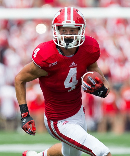 Sep 7, 2013; Madison, WI, USA; Wisconsin Badgers wide receiver Jared Abbrederis (4) rushes with the football after catching a pass during the third quarter against the Tennessee Tech Golden Eagles at Camp Randall Stadium.  Wisconsin won 48-0.  Mandatory Credit: Jeff Hanisch-USA TODAY Sports