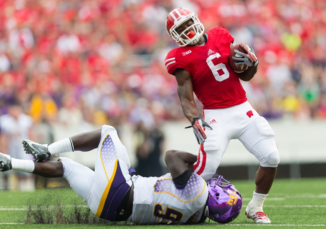 Sep 7, 2013; Madison, WI, USA; Wisconsin Badgers running back Corey Clement (6) rushes with the football as   Tennessee Tech Golden Eagles defensive end Malcolm Mitchell (94) defends during the fourth quarter at Camp Randall Stadium.  Wisconsin won 48-0.  Mandatory Credit: Jeff Hanisch-USA TODAY Sports