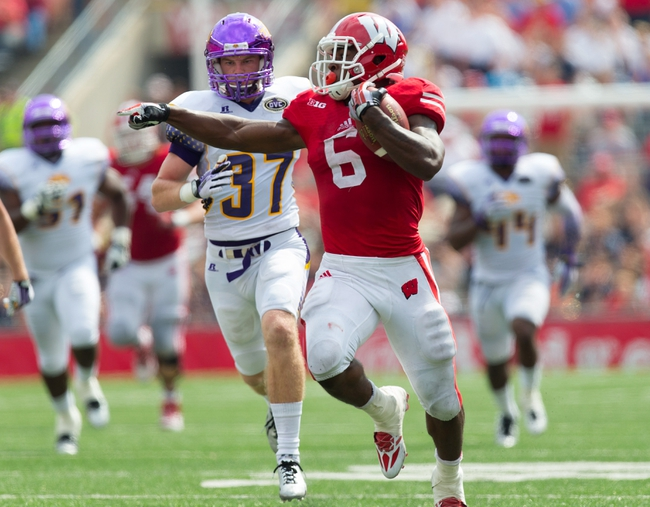 Sep 7, 2013; Madison, WI, USA; Wisconsin Badgers running back Corey Clement (6) rushes for a touchdown during the fourth quarter against the Tennessee Tech Golden Eagles at Camp Randall Stadium.  Wisconsin won 48-0.  Mandatory Credit: Jeff Hanisch-USA TODAY Sports