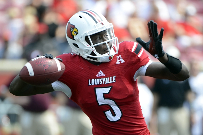 Sep 7, 2013; Louisville, KY, USA; Louisville Cardinals quarterback Teddy Bridgewater (5) looks to pass against the Eastern Kentucky Colonels during the second half of play at Papa John's Cardinal Stadium. Louisville defeated Eastern Kentucky 44-7.  Mandatory Credit: Jamie Rhodes-USA TODAY Sports