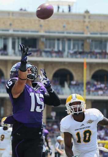 Sep 7, 2013; Fort Worth, TX, USA; TCU Horned Frogs wide receiver Cameron Echols-Luper (15) cannot catch the pass ahead of Southeastern Louisiana Lions defensive back James Scales III (10) during the game at Amon G. Carter Stadium. Mandatory Credit: Kevin Jairaj-USA TODAY Sports