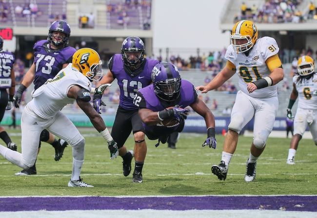 Sep 7, 2013; Fort Worth, TX, USA; TCU Horned Frogs running back Aaron Green (22) dives and scores a touchdown during the game against the Southeastern Louisiana Lions at Amon G. Carter Stadium. Mandatory Credit: Kevin Jairaj-USA TODAY Sports