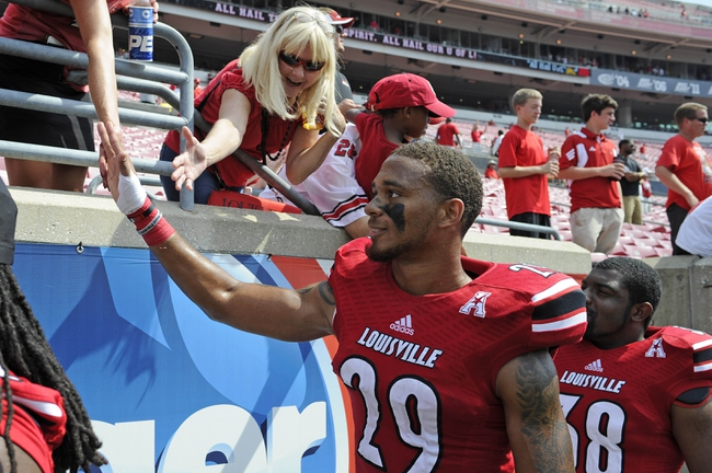 Sep 7, 2013; Louisville, KY, USA; Louisville Cardinals safety Hakeem Smith (29) celebrates with the fans after the game against Eastern Kentucky Colonels at Papa John's Cardinal Stadium. Louisville defeated Eastern Kentucky 44-7.  Mandatory Credit: Jamie Rhodes-USA TODAY Sports