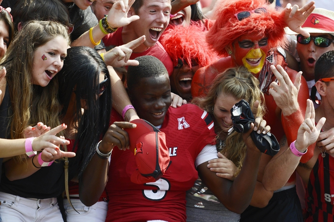 Sep 7, 2013; Louisville, KY, USA; Louisville Cardinals quarterback Teddy Bridgewater (5) celebrates with the fans after the game against Eastern Kentucky Colonels at Papa John's Cardinal Stadium. Louisville defeated Eastern Kentucky 44-7.  Mandatory Credit: Jamie Rhodes-USA TODAY Sports