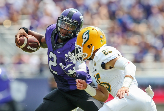Sep 7, 2013; Fort Worth, TX, USA; TCU Horned Frogs quarterback Trevone Boykin (2) runs as Southeastern Louisiana Lions defensive back Trenon Trosclair (25) tries to tackle him during the game at Amon G. Carter Stadium. Mandatory Credit: Kevin Jairaj-USA TODAY Sports