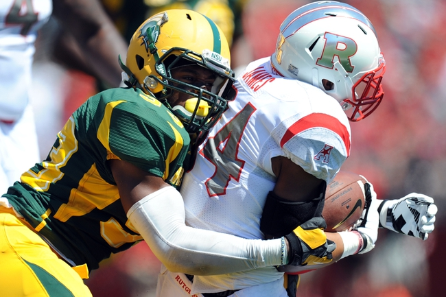 Sep 7, 2013; Piscataway, NJ, USA; Rutgers Scarlet Knights running back Paul James (34) is tackled by Norfolk State Spartans defensive lineman Clifford Fortune (93) during the first half at High Point Solutions Stadium. Rutgers won the game 38-0. Mandatory Credit: Joe Camporeale-USA TODAY Sports