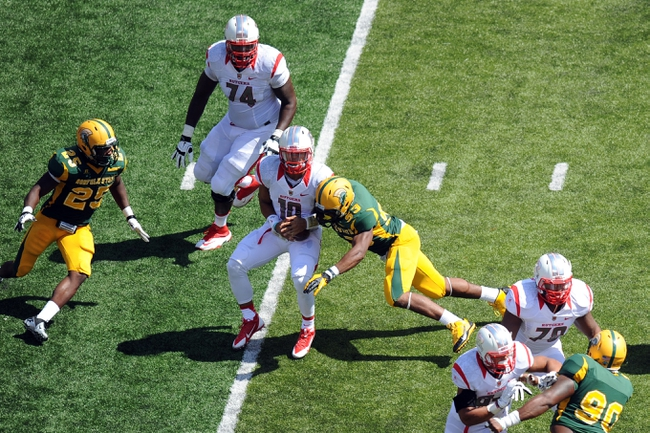 Sep 7, 2013; Piscataway, NJ, USA; Norfolk State Spartans linebacker Deon King (53) sacks Rutgers Scarlet Knights quarterback Gary Nova (10) during the second half at High Point Solutions Stadium. Rutgers won the game 38-0. Mandatory Credit: Joe Camporeale-USA TODAY Sports