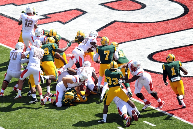 Sep 7, 2013; Piscataway, NJ, USA; Rutgers Scarlet Knights running back Savon Huggins (28) runs for a touchdown against the Norfolk State Spartans during the second half at High Point Solutions Stadium. Rutgers won the game 38-0. Mandatory Credit: Joe Camporeale-USA TODAY Sports