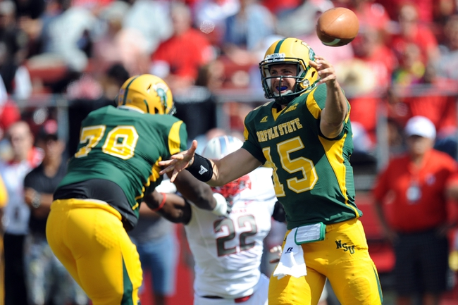 Sep 7, 2013; Piscataway, NJ, USA; Norfolk State Spartans quarterback Tyler Clark (15) throws a pass against the Rutgers Scarlet Knights during the second half at High Point Solutions Stadium. Rutgers won the game 38-0. Mandatory Credit: Joe Camporeale-USA TODAY Sports