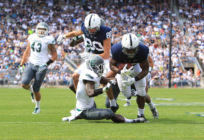 Sep 7, 2013; University Park, PA, USA; Penn State Nittany Lions running back Akeel Lynch (22) runs the ball during the fourth quarter against the Eastern Michigan Eagles at Beaver Stadium. Penn State defeated Eastern Michigan 45-7. Mandatory Credit: Matthew O'Haren-USA TODAY Sports