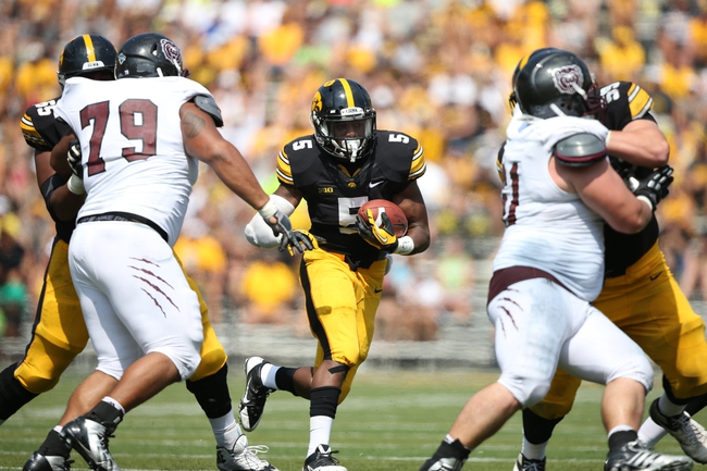 Sep 7, 2013; Iowa City, IA, USA; Iowa Hawkeyes running back Damon Bullock (5) carries the football against the Missouri State Bears at Kinnick Stadium.  Iowa beat Missouri State 28-14.  Mandatory Credit: Reese Strickland-USA TODAY Sports