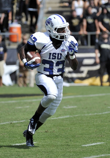 Sep 7, 2013; West Lafayette, IN, USA;  Indiana State Sycamores wide receiver Taje High (33) runs back a kick-off against the Purdue Boilermakers in the 2nd half at Ross Ade Stadium. Mandatory Credit: Sandra Dukes-USA TODAY Sports
