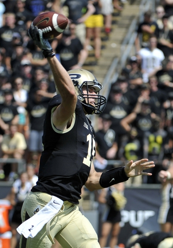 Sep 7, 2013; West Lafayette, IN, USA;  Purdue Boilermakers quarterback Rob Henry (15) throws a pass in the 2nd half against the Indiana State Sycamores at Ross Ade Stadium. Mandatory Credit: Sandra Dukes-USA TODAY Sports