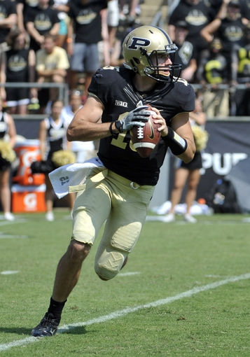 Sep 7, 2013; West Lafayette, IN, USA;  Purdue Boilermakers quarterback Rob Henry (15) rolls out to pass against the Indiana State Sycamores in the 2nd half at Ross Ade Stadium. Mandatory Credit: Sandra Dukes-USA TODAY Sports