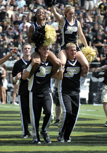 Sep 7, 2013; West Lafayette, IN, USA;  Purdue Boilermakers cheerleaders celebrates after a touchdown in the second half against the Indiana State Sycamores at Ross Ade Stadium. Mandatory Credit: Sandra Dukes-USA TODAY Sports