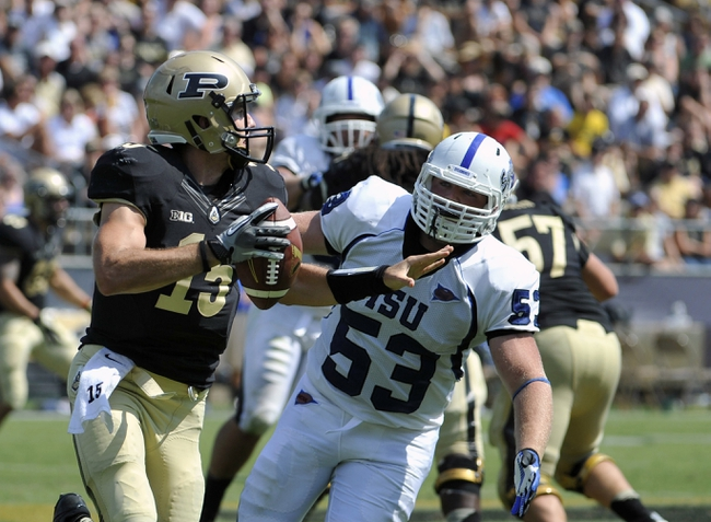 Sep 7, 2013; West Lafayette, IN, USA;  Purdue Boilermakers quarterback Rob Henry (15) looks to pass as Indiana State Sycamores defensive lineman Russell Jones (53) closes in during the 2nd half at Ross Ade Stadium. Mandatory Credit: Sandra Dukes-USA TODAY Sports