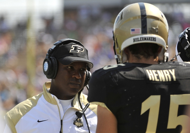 Sep 7, 2013; West Lafayette, IN, USA;  Purdue Boilermakers head coach Darrell Hazell talks with quarterback Rob Henry (15) in the 2nd half against the Indiana State Sycamores at Ross Ade Stadium. Mandatory Credit: Sandra Dukes-USA TODAY Sports