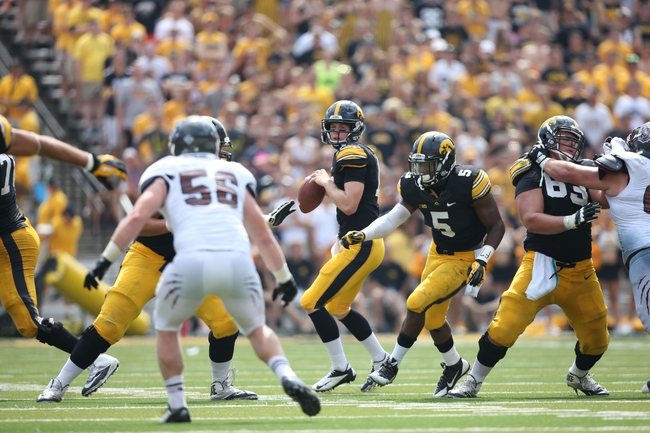 Sep 7, 2013; Iowa City, IA, USA; Iowa Hawkeyes quarterback Jake Rudock (15) drops back to pass against the Missouri State Bears at Kinnick Stadium.  Iowa beat Missouri State 28-14.  Mandatory Credit: Reese Strickland-USA TODAY Sports
