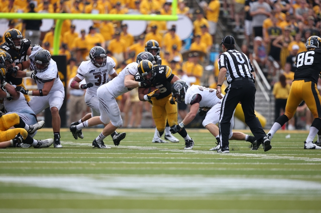 Sep 7, 2013; Iowa City, IA, USA; Iowa Hawkeyes running back Mark Weisman (45) is tackled by linebacker Tim Piccarreto (56) and safety Brandon Cheaton (27) Missouri State Bears at Kinnick Stadium.  Iowa beat Missouri State 28-14.  Mandatory Credit: Reese Strickland-USA TODAY Sports