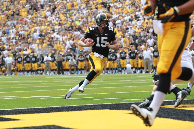Sep 7, 2013; Iowa City, IA, USA; Iowa Hawkeyes quarterback Jake Rudock (15) runs in for the touchdown against the Missouri State Bears at Kinnick Stadium.  Iowa beat Missouri State 28-14.  Mandatory Credit: Reese Strickland-USA TODAY Sports