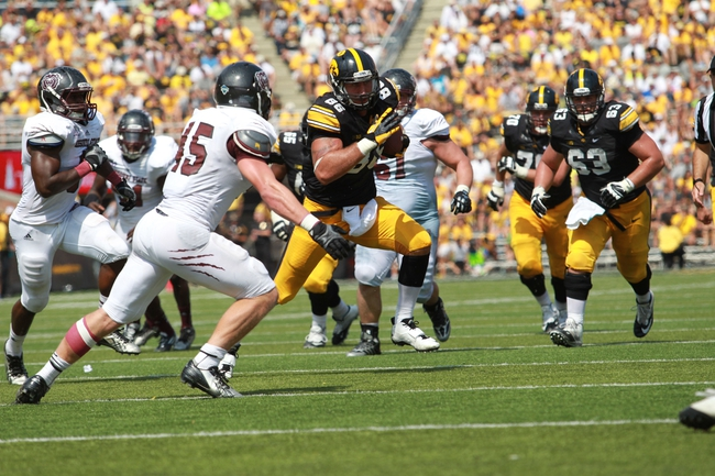 Sep 7, 2013; Iowa City, IA, USA; Missouri State Bears linebacker Christian Hoffmann (45) tackles Iowa Hawkeyes C.J. Fiedorowicz (86) at Kinnick Stadium.  Iowa beat Missouri State 28-14.  Mandatory Credit: Reese Strickland-USA TODAY Sports