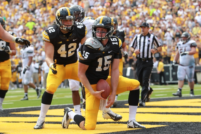 Sep 7, 2013; Iowa City, IA, USA; Iowa Hawkeyes quarterback Jake Rudock (15) poses in the end zone after scoring the touchdown against the Missouri State Bears at Kinnick Stadium.  Iowa beat Missouri State 28-14.  Mandatory Credit: Reese Strickland-USA TODAY Sports