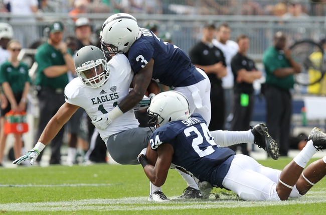Sep 7, 2013; University Park, PA, USA; Eastern Michigan Eagles running back Tyler Allen (11) is tackled by Penn State Nittany Lions cornerbacks Da'Quan Davis (3) and Anthony Smith (24) during the fourth quarter at Beaver Stadium. Penn State defeated Eastern Michigan 45-7. Mandatory Credit: Matthew O'Haren-USA TODAY Sports