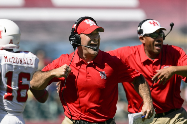 Sep 7, 2013; Philadelphia, PA, USA; Houston Cougars head coach Tony Levine celebrates a play during the third quarter against the Temple Owls at Lincoln Financial Field. Houston defeated temple 22-13. Mandatory Credit: Howard Smith-USA TODAY Sports