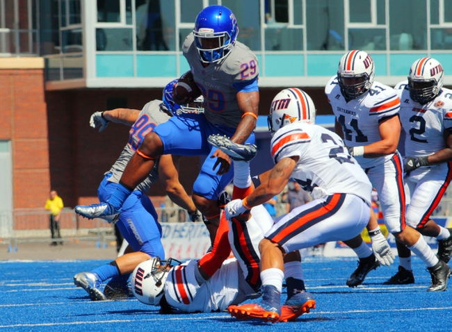 Sep 7, 2013; Boise, ID, USA; Boise State Broncos running Aaron Baltazar (29) leaps over Tennessee Martin Skyhawks defensive back Walter Evans (26) during the first half at Bronco Stadium. Mandatory Credit: Brian Losness-USA TODAY Sports