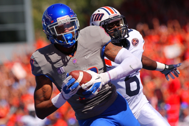 Sep 7, 2013; Boise, ID, USA; Boise State Broncos wide receiver Aaron Burks (18) catches a touchdown pass during the first half against the Tennessee Martin Skyhawks at Bronco Stadium. Mandatory Credit: Brian Losness-USA TODAY Sports