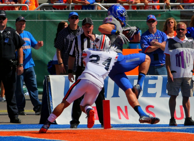 Sep 7, 2013; Boise, ID, USA; Boise State Broncos wide receiver Kirby Moore (34) catches a touchdown pass as Tennessee Martin Skyhawks defensive back Jordan Landry (24) defends during the first half at Bronco Stadium. Mandatory Credit: Brian Losness-USA TODAY Sports