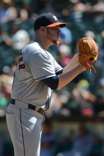 September 7, 2013; Oakland, CA, USA; Houston Astros starting pitcher Brett Oberholtzer (65) delivers a pitch against the Oakland Athletics during the second inning at O.co Coliseum. Mandatory Credit: Kyle Terada-USA TODAY Sports