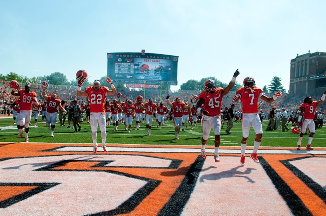 Sep 7, 2013; Champaign, IL, USA; Illinois Fighting Illini players celebrate after beating the Cincinnati Bearcats 45-17 at Memorial Stadium. Mandatory Credit: Bradley Leeb-USA TODAY Sports