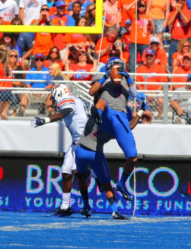 Sep 7, 2013; Boise, ID, USA; Boise State Broncos safety Darian Thompson (4) picks off a pass thrown by Tennessee Martin Skyhawks quarterback Dylan Favre (1) during the first half at Bronco Stadium. Mandatory Credit: Brian Losness-USA TODAY Sports