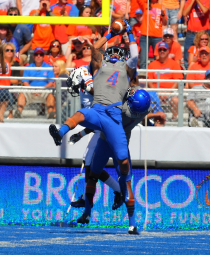 Sep 7, 2013; Boise, ID, USA; Boise State Broncos safety Darian Thompson (4) picks off a pass thrown by Tennessee Martin Skyhawks quarterback Dylan Favre (1) during the first half at Bronco Stadium. Mandatory Credit: Brian Losness-USA TODAY Sports8