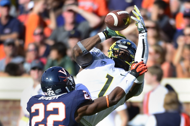 Sep 7, 2013; Charlottesville, VA, USA; Oregon Ducks wide receiver Josh Huff (1) makes a catch near the goal line in the second quarter as Virginia Cavaliers cornerback DreQuan Hoskey (22) defends at Scott Stadium. Mandatory Credit: Bob Donnan-USA TODAY Sports