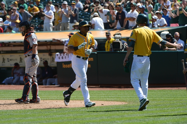 September 7, 2013; Oakland, CA, USA; Oakland Athletics left fielder Yoenis Cespedes (52, center) is congratulated by the bat boy against Houston Astros catcher Matt Pagnozzi (44, left) during the fourth inning at O.co Coliseum. Mandatory Credit: Kyle Terada-USA TODAY Sports