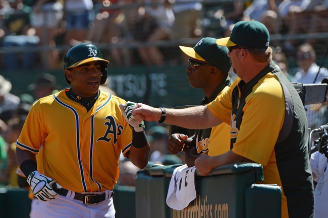 September 7, 2013; Oakland, CA, USA; Oakland Athletics left fielder Yoenis Cespedes (52, left) is congratulated for hitting a solo home run against the Houston Astros during the fourth inning at O.co Coliseum. Mandatory Credit: Kyle Terada-USA TODAY Sports